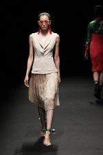 GRANDI Tokyo Fashion Week champagne vest pleated skirt Black iris lenses