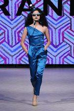 GRANDI Vancouver Fashion Week party girl teal one shoulder jumpsuit Black Iris lenses